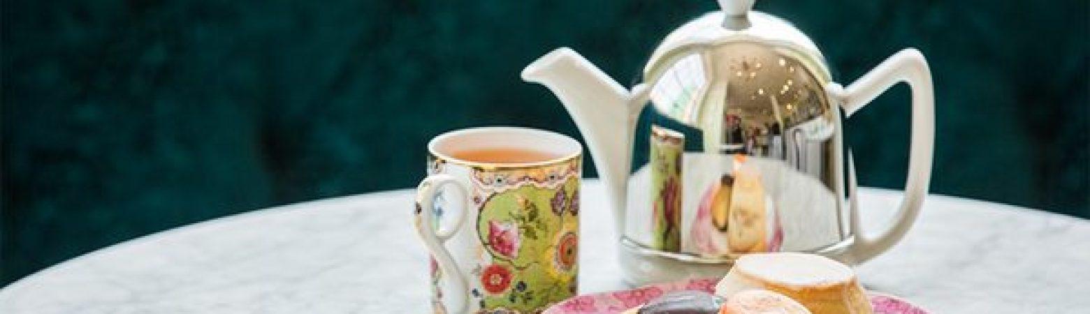 Jolie Tea plate with tea cakes, a mug of tea and tea pot