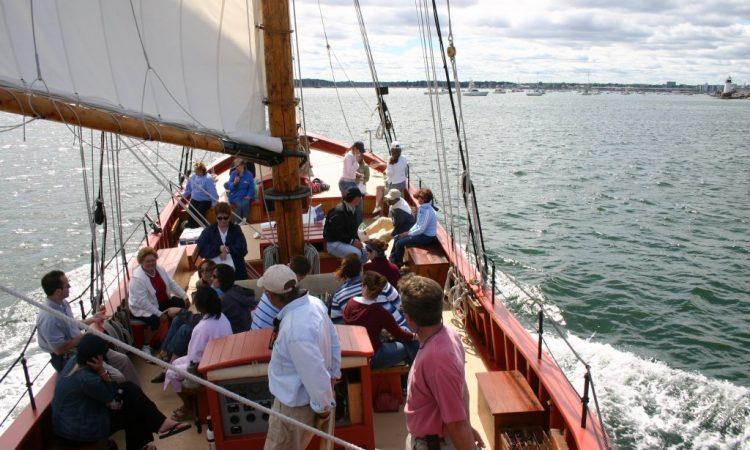 Tourists ride the Schooner Fame